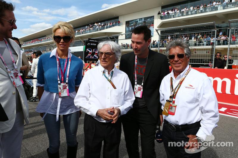 (L to R): Simon Le Bon, Duran Duran Lead Singer with Pamela Anderson, Actress; Bernie Ecclestone, Ac