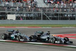 Lewis Hamilton, Mercedes AMG F1 W05 passes team mate Nico Rosberg, Mercedes AMG F1 W05 to take the lead of the race