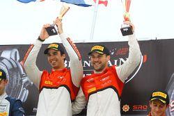 Qualifying race podium: winners Cesar Ramos, Laurens Vanthoor