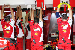 Ferrari mechanics limber up