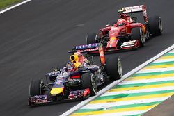 Sebastian Vettel, Red Bull Racing RB10 leads Kimi Raikkonen, Ferrari F14-T