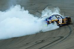 2014 champion Chase Elliott celebrates