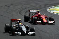 Esteban Gutierrez, Sauber C33 leads Kimi Raikkonen, Ferrari F14-T
