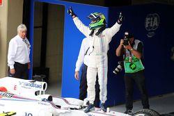 Felipe Massa, Williams FW36, celebra su tercera posición en el parque cerrado
