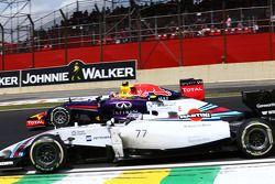 Daniel Ricciardo, Red Bull Racing RB10 and Valtteri Bottas, Williams FW36