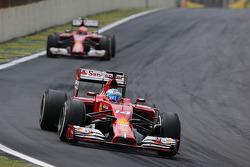 Fernando Alonso, Scuderia Ferrari; Kimi Räikkönen, Scuderia Ferrari