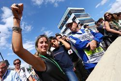 Rafaela Bassi, and son Felipinho Massa, celebrate at the end of the race