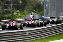 Jean-Eric Vergne, Scuderia Toro Rosso STR9 and other cars at the end of the pit lane