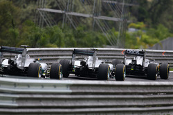 Kevin Magnussen, McLaren MP4-29; Nico Rosberg, Mercedes AMG F1 W05; and Lewis Hamilton, Mercedes AMG