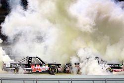 Race winner Darrell Wallace Jr. and teammate Kyle Busch celebrate