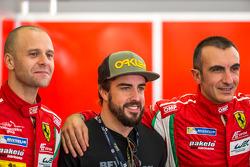 Gianmaria Bruni and Andrea Bertolini with Fernando Alonso