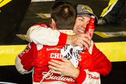 Race winner and 2014 NASCAR Sprint Cup series champion Kevin Harvick, Stewart-Haas Racing Chevrolet celebrates with crew chief Rodney Childers