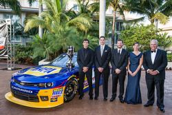 NASCAR Nationwide Series champion driver Chase Elliott with owners Dale Earnhardt Jr., Kelley Earnhardt, Rick Hendrick, crew chief Greg Ives