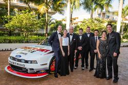 NASCAR Nationwide Series champion owner Roger Penske poses with drivers Brad Keselowski, Ryan Blaney