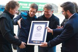 Stunt truck driver Mike Ryan is presented with the World Record after jumping over an F1 car