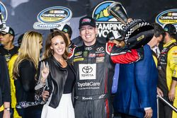Championship victory lane: NASCAR Camping World Truck Series 2014 champion owner Kyle Busch with wife Samantha