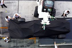 The McLaren MP4-29 of Stoffel Vandoorne, McLaren Test and Reserve Driver is recovered back to the pits on the back of a truck