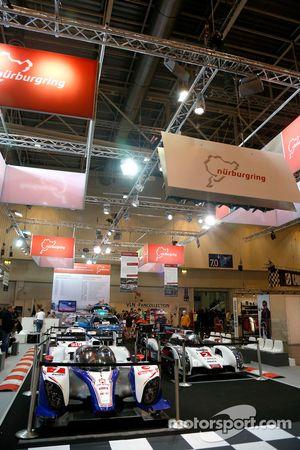 Toyota, Audi, Porsche cars on display