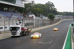 The Ferrari of Matteo Cressoni is taken away after a major crash with Mark Webber