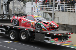 The Ferrari of Matteo Cressoni is taken away after a major crash with Mark Webber