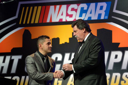 NASCAR Mexico Series champion Abraham Calderon gets a championship ring from NASCAR president Mike H