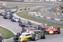 Jean-Pierre Jabouille, Renault RE20,  leads Nelson Piquet, Brabham BT49-Ford Cosworth, hidden, Bruno Giacomelli, Alfa Romeo 179B, Gilles Villeneuve, Jody Scheckter, both Ferrari 312T5, Mario Andretti, Lotus 81-Ford Cosworth, John Watson, McLaren M29C-Ford Cosworth, Didier Pironi, Ligier JS11/15-Ford Cosworth, Elio de Angelis, Lotus 81-Ford Cosworth, Riccardo Patrese, Arrows A3-Ford Cosworth, Jean-Pierre Jarier, Tyrrell 010-Ford Cosworth, Eddie Cheever, Osella FA1-Ford Cosworth,  and Nigel Mansell, Lotus 81B-Ford Cosworth, at the start