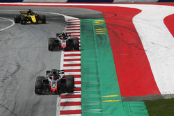 Romain Grosjean, Haas F1 Team VF-18, leads Kevin Magnussen, Haas F1 Team VF-18, and Nico Hulkenberg, Renault Sport F1 Team R.S. 18, to the grid