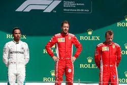 Podio: segundo lugar Lewis Hamilton, Mercedes-AMG F1, ganador de la carrera Sebastian Vettel, Ferrari y tercer lugar Kimi Raikkonen, Ferrari