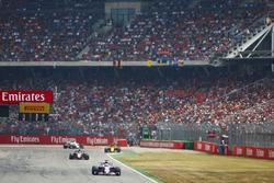 Sergio Perez, Force India VJM11, leadsRomain Grosjean, Haas F1 Team VF-18