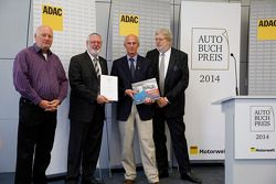 Reinhard Klein, publisher, Thomas Burkhardt from ADAC, Author Ed Heuvink and Jürgen Lewandowski, head of selection jury present Heuvink the AutoBuchPress Award