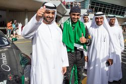 Race winner Abdulaziz Al Faisal celebrates with friend