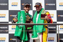 General podium: race winner Abdulaziz Al Faisal celebrates with Mohammed Jawa