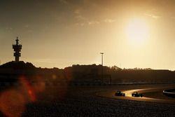 (L to R): Daniil Kvyat, Red Bull Racing RB11 and Lewis Hamilton, Mercedes AMG F1 W06