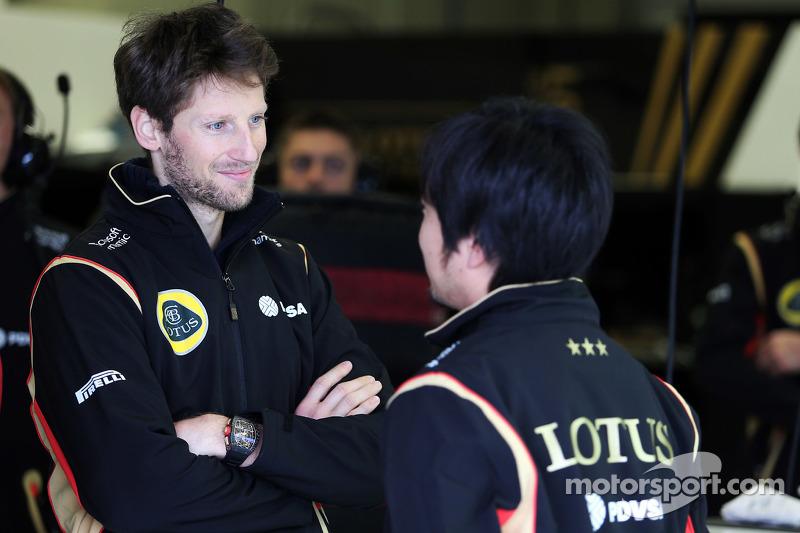 Romain Grosjean, Lotus F1 Team with Ayao Komatsu, Lotus F1 Team Race Engineer