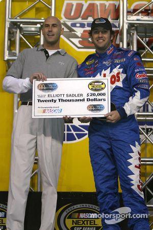 Drivers presentation: Elliott Sadler receives a check