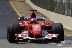Pole winner Rubens Barrichello celebrates
