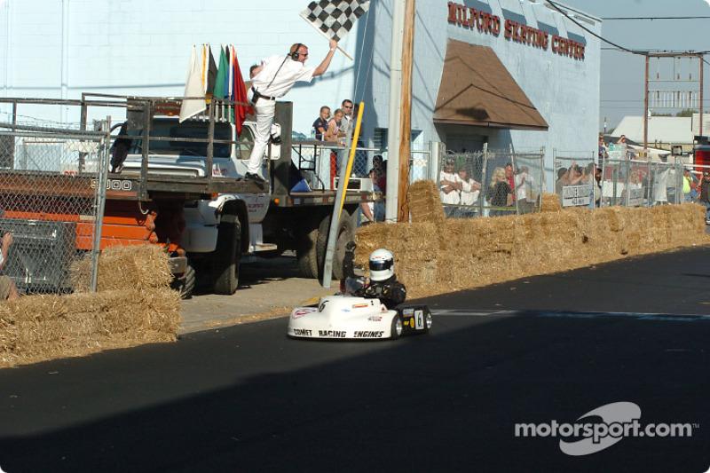 #6-Rober Smith takes the Rodney J. Harrington Memorial Pro Race's checkered flag