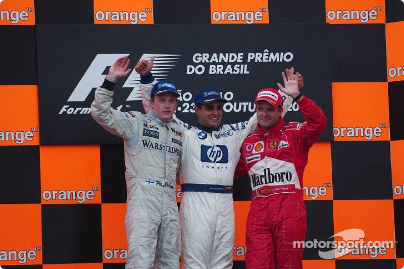 Podio: gandor de la carreraJuan Pablo Montoya con Kimi Raikkonen y Rubens Barrichello