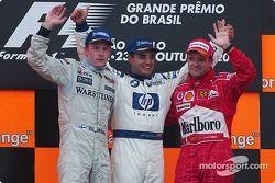 Podio: il vincitore della gara Juan Pablo Montoya con Kimi Raikkonen e Rubens Barrichello