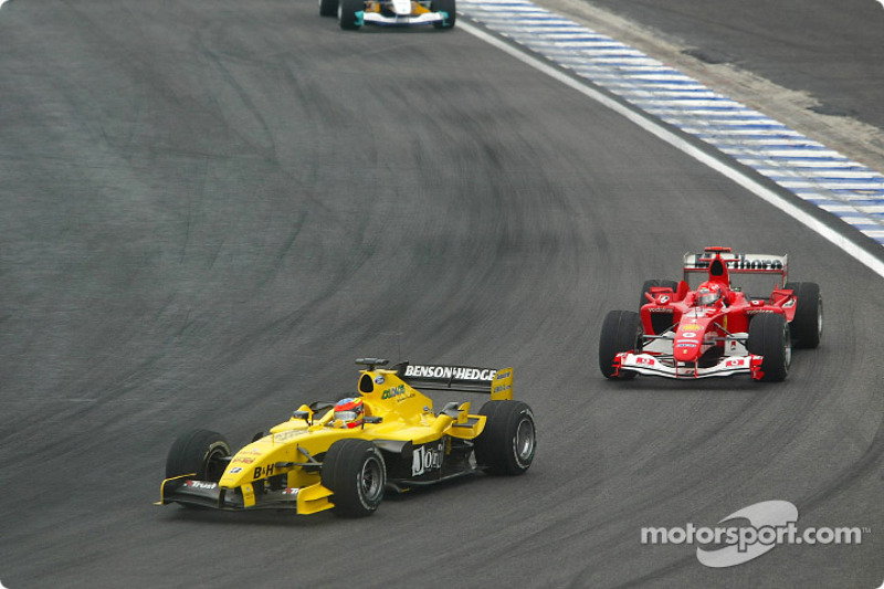 Timo Glock y Michael Schumacher