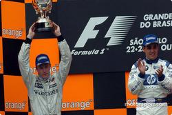 Podium: Kimi Raikkonen and Juan Pablo Montoya