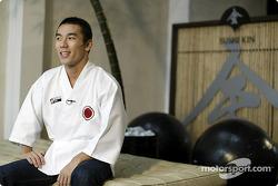 Takuma Sato tries his hand at sushi preparation in Sao Paulo