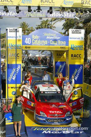 Podio: terceros Carlos Sainz y Marc Marti