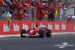 Michael Schumacher takes checkered flag