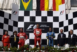 Podium: race winner Michael Schumacher with Rubens Barrichello and Fernando Alonso