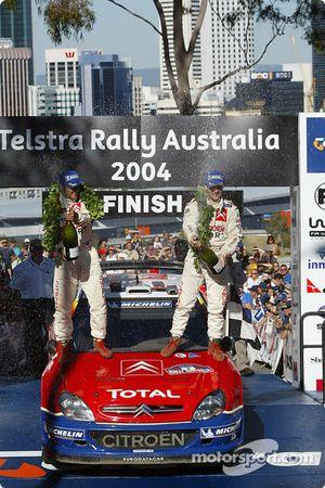 Podium: champagne for rally winners Sébastien Loeb and Daniel Elena