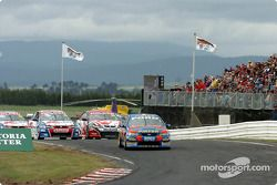 Marcos Ambrose gets away from Rick Kelly
