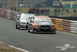Jason Richards and Jason Bargwanna down the front straight