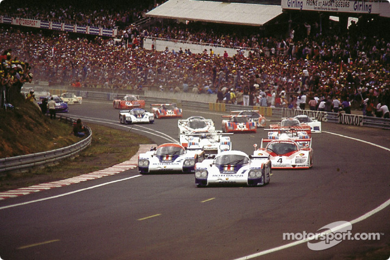 Start: #1 Rothmans Porsche Porsche 956: Jacky Ickx, Derek Bell takes the lead in front of #2 Rothmans Porsche Porsche 956: Jochen Mass, Vern Schuppan