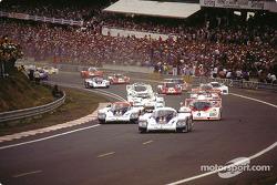 Start: #1 Rothmans Porsche Porsche 956: Jacky Ickx, Derek Bell takes the lead in front of #2 Rothmans Porsche Porsche 956: Jochen Mass, Vern Schuppan